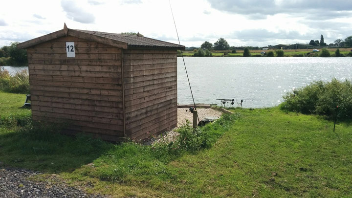 Quarry carp fishing hut side view